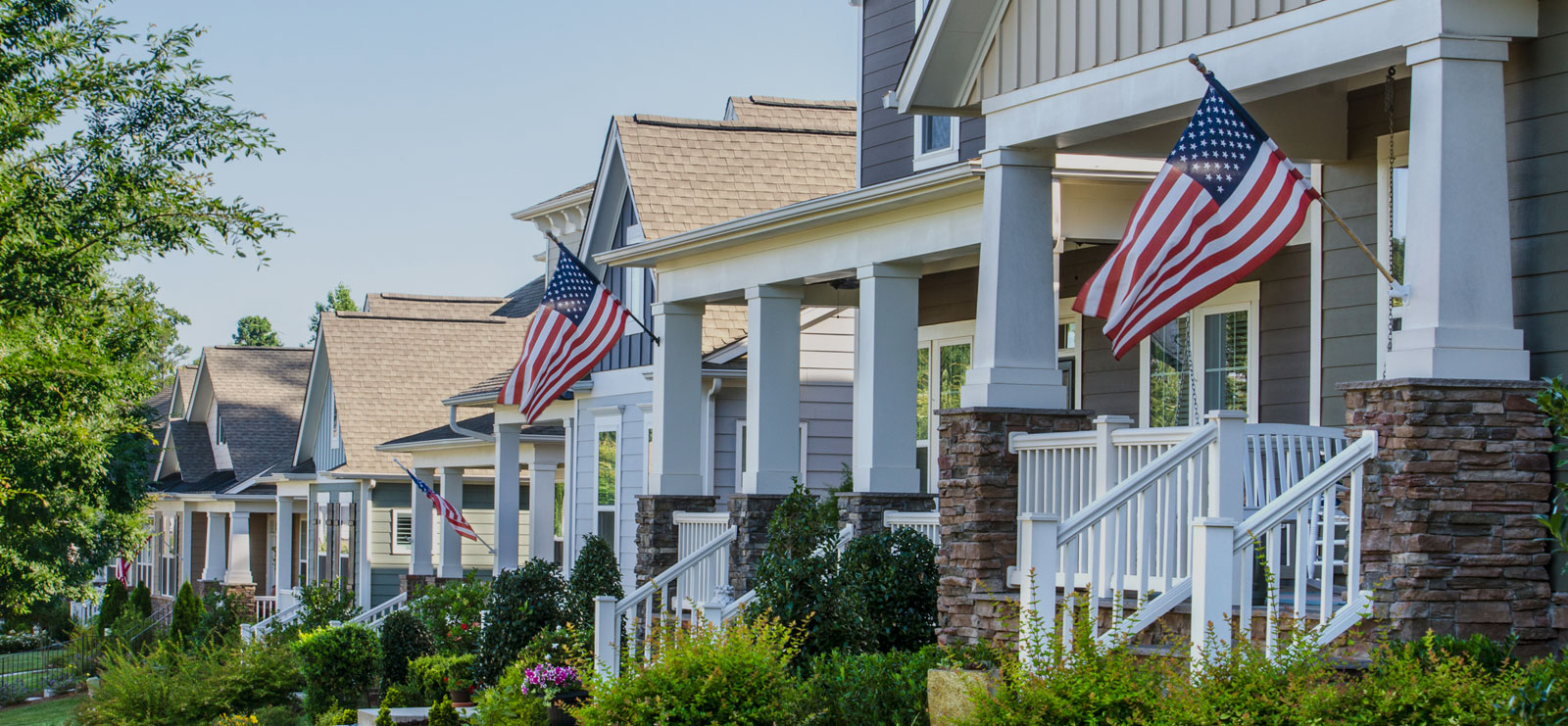 Front porch with US flags